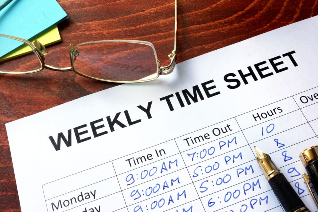 weekly hours time sheet with pen